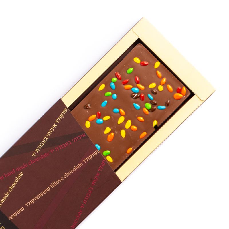 התמונה הראשית של טבלת שוקולד חלב 60 גרם עם תוספות - גוונים של מתוק